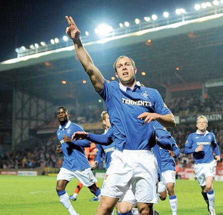 Steven Whittaker celebrates scoring his second penalty in Rangers' 4-0 victory over Dundee United
