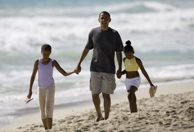 President Obama with his daughters in Hawaii