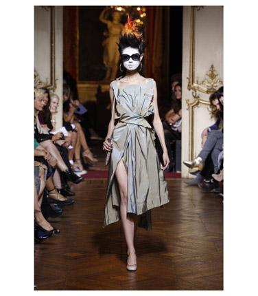 This year's Dress Of The Year breaks the mould somewhat as it was chosen by a designer for the first time - milliner Stephen Jones. His choice is a spring / summer 2010 Vivienne Westwood Gold Label dress