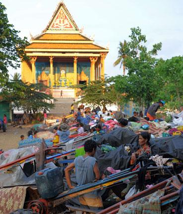 Cambodian villagers evacuated during clashes rest at a pagoda in Oddar Meanchey province