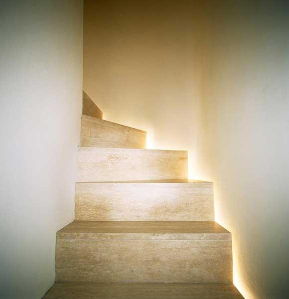 For visual excitement, illuminate stairs with small recess lights, set at low level to cast light on every other tread