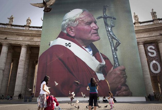 A photo of the late Pope John Paul II hanging from a stage set up near St Peter's Square in Rome on Friday, where today Pope Benedict XVI beatified him - the last major hurdle before he is declared a saint