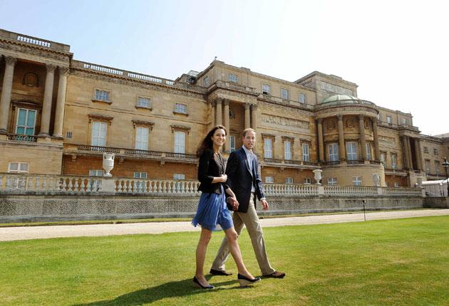The Duke and Duchess of Cambridge in the grounds of Buckingham Palace before flying off to a secret destination for the weekend by helicopter