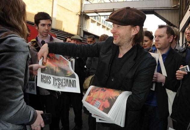Press the flesh: Thom Yorke hands out the Radiohead newspaper
