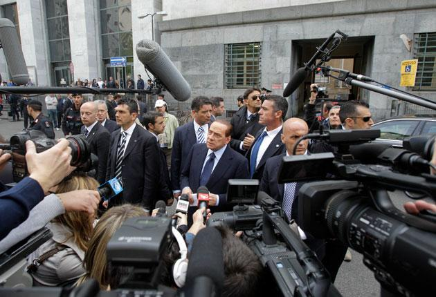 Silvio Berlusconi vents his frustration as he arrives at the court in Milan yesterday