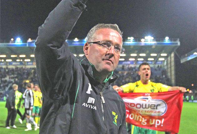 Paul Lambert (left) celebrates Norwich's promotion after their win at Fratton Park