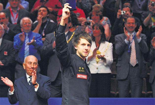 Judd Trump enjoys the crowd's acclaim after receiving his runner-up prize at the Crucible on Monday