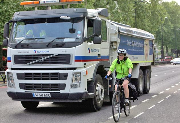 Lee Ruggles drives around London, using a monitoring system to avoid cyclists