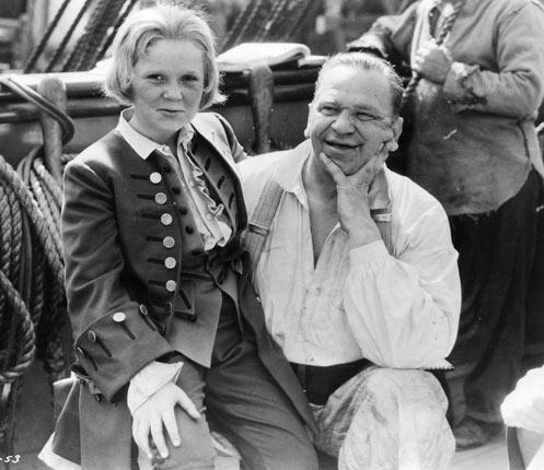 Cooper, left, and Wallace Beery on the set of 'Treasure Island'