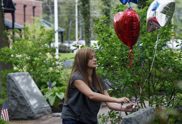 Kristen Grazioso, 14, places balloons in Middletown's 9/11 Memorial Garden