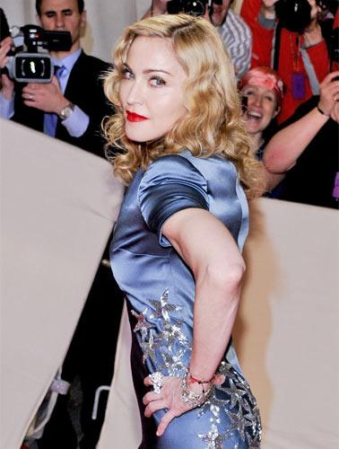 Federal investigators are looking into the finances of two charities with close links to Madonna