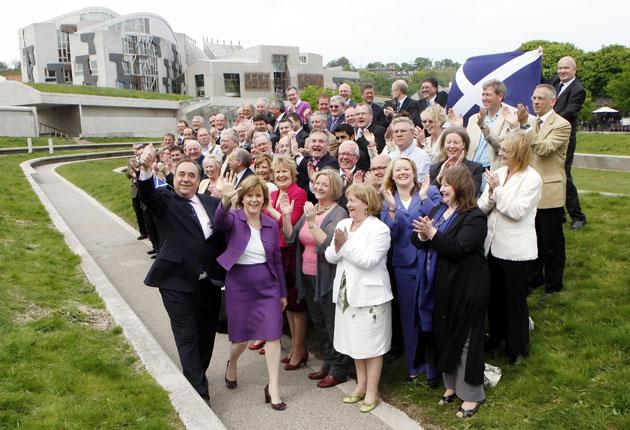 Alex Salmond with his newly elected MSPs outside the Scottish Parliament in Edinburgh yesterday