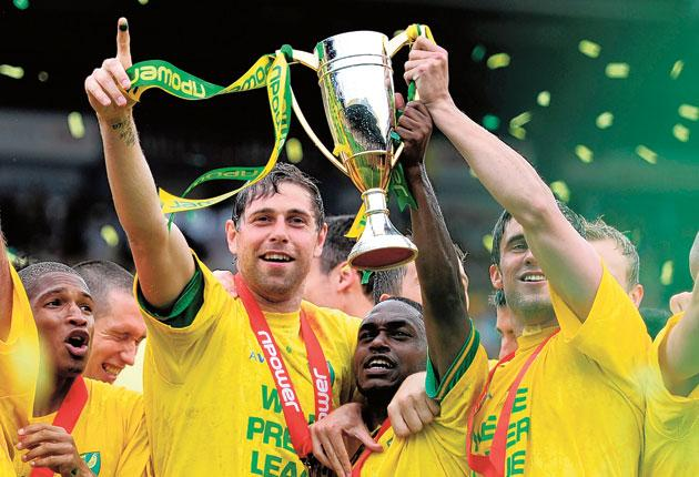 Norwich City captain Grant Holt (left) leads the promotion celebrations after the 2-2 draw with Coventry City at Carrow Road on Saturday