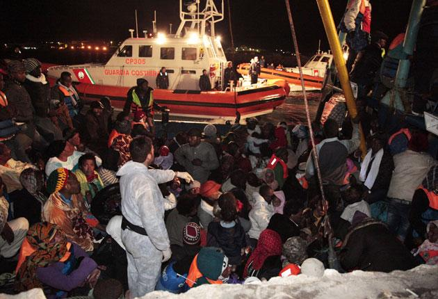 Libyan refugees arrive on the island of Lampedusa, Italy, at the weekend