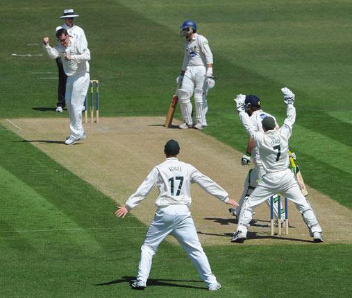 Nottinghamshire's Graeme Swann celebrates taking the wicket of Sussex's Ed Joyce yesterday
