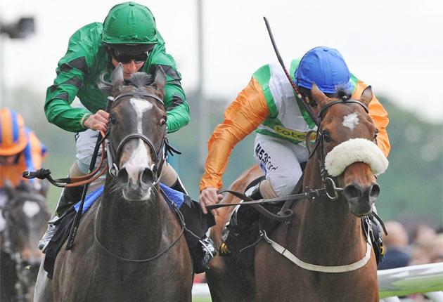 Joviality (left) wins York's Musidora Stakes on the nod from Barefoot Lady