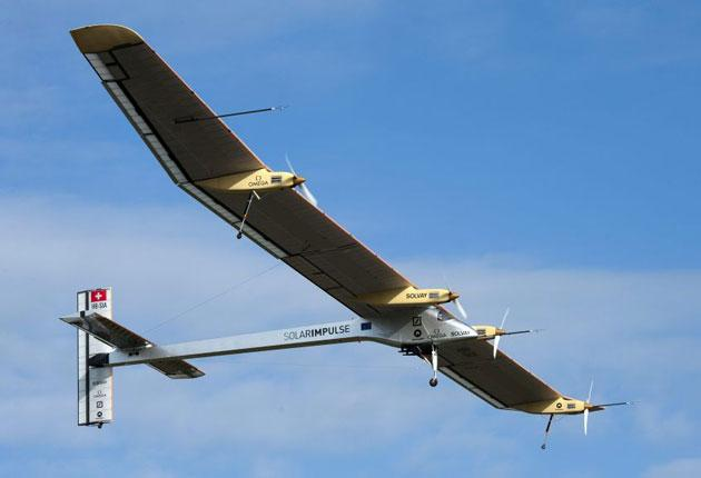 The experimental aircraft Solar Impulse takes off for its first international flight to Brussels