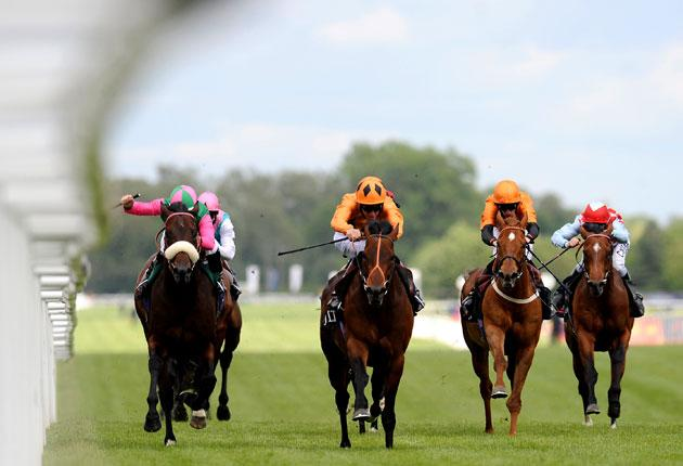 Richard Hughes riding Canford Cliffs (centre) to victory in the Lockinge Stakes at Newbury