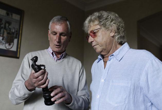 Peter Shepherd (left) hands over the statuette to Gary Osborne, the lyricist on 'The War of the Worlds'