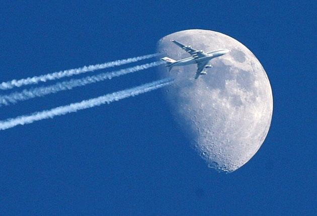 Blue sky thinking: a jumbo jet flies past the moon. Is the airline industry doing enough to stay up in the air when jet fuel runs out?