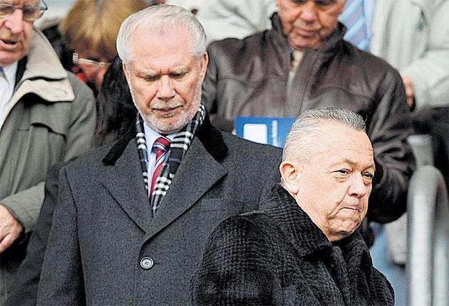David Sullivan (right) and David Gold at Wigan game