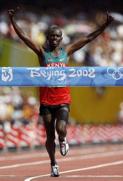 A victorious Wanjiru crosses the line in the 2008 Olympic marathon