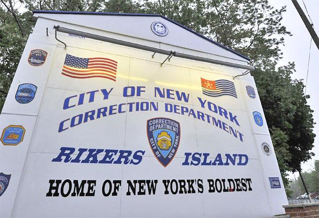 Rikers Island, a collection of buldings close to La Guardia airport, where New York City Corrections Department said the banker spent an 'uneventful' first night