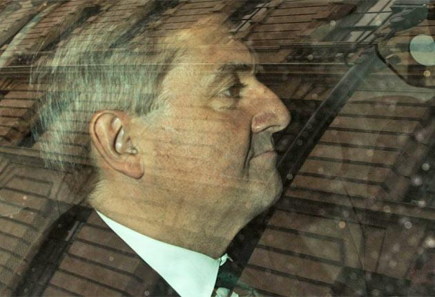 Chris Huhne leaves Whitehall yesterday