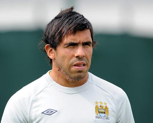 Carlos Tevez is bemused by his manager Roberto Mancini announcing the striker's intention to stay at City