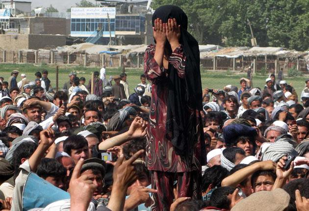 A girl who lost family members in the raid weeps during the protest