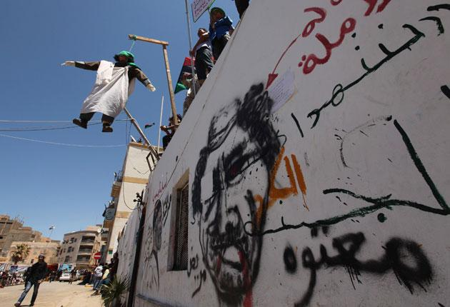 An effigy of Colonel Gaddafi hangs in the rebel city of Benghazi on Friday