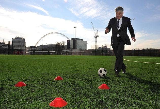 FA chairman David Bernstein tests out a new 3G artificial pitch at Wembley. The FA are desperate for a strong, merciless, respected hand