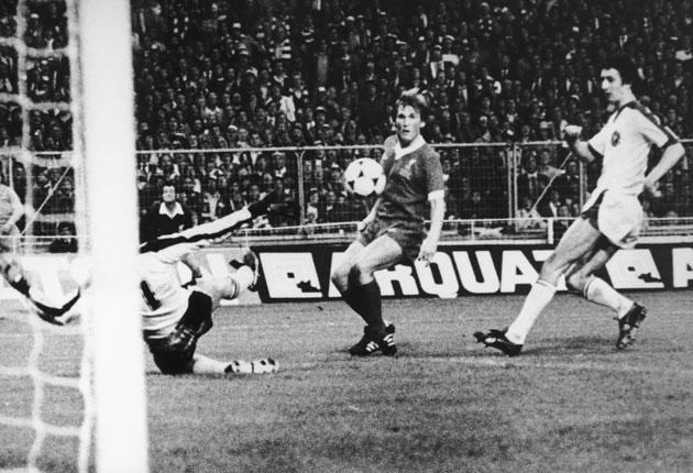 Kenny Dalglish lifts the ball over the Bruges keeper Birger Jensen at Wembley in 1978 as Liverpool retained the European Cup