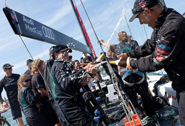 Celebrations aboard the American boat Quantum after winning the opening Cascais Trophy regatta of the 2011 Audi MedCup series