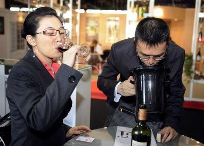 Chinese wine professionnals taste wine at the international wine fair Vinexpo in Bordeaux.
