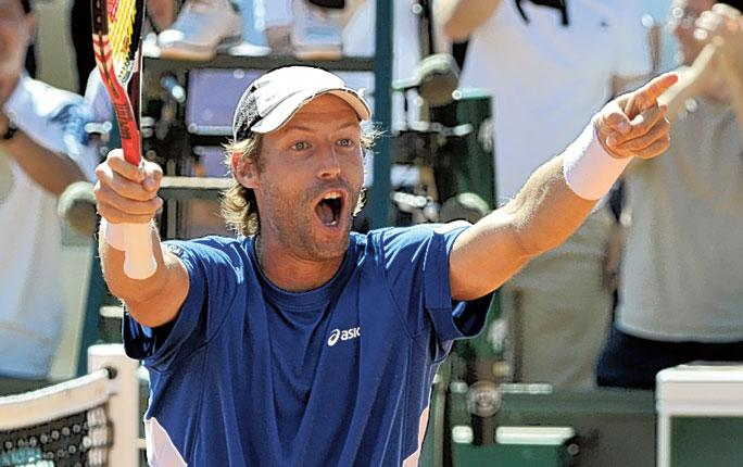 Stephane Robert celebrates yesterday's first-round win over Tomas Berdych