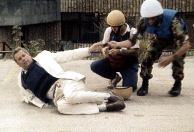 Taking the flak jacket: Martin Bell is injured by shrapnel in Bosnia