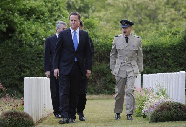 Prime Minister David Cameron  visits Tourgeville Military Cemetery