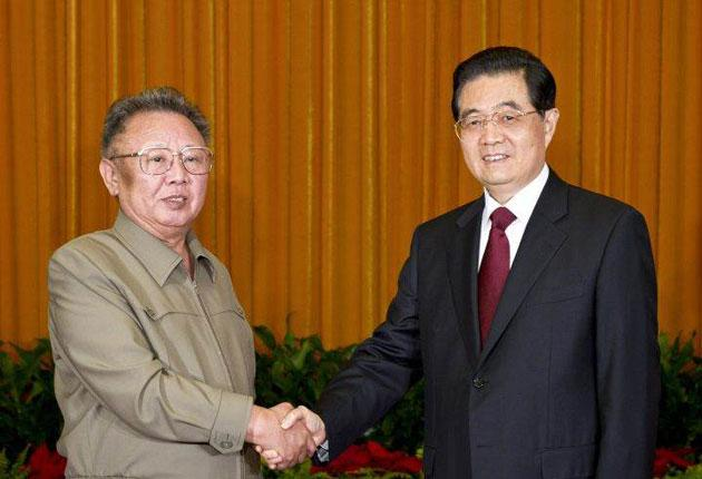 Kim Jong-il with Hu Jintao in Beijing during his tour of China yesterday