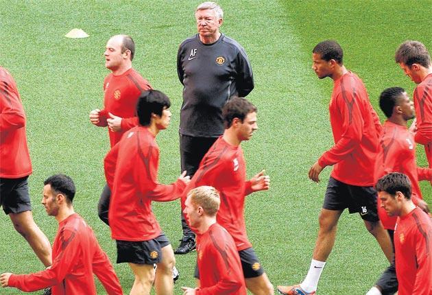 Sir Alex Ferguson watches Manchester United training at Wembley yesterday