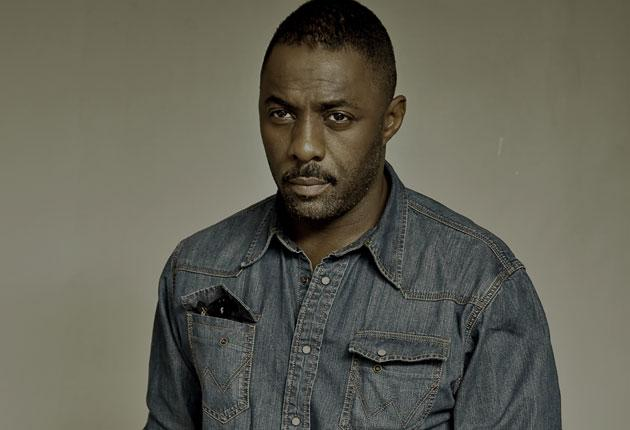 Idris Elba, photographed in London last month. He says: 'My next project might be to get Charlize Theron to sing with me'