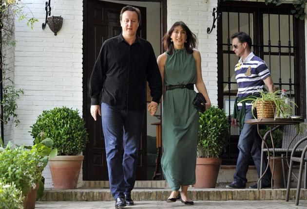 David Cameron and his wife Samantha step out of the Realejo hotel, in Granada, southern Spain, after taking a low-cost Ryanair flight to Malaga in April