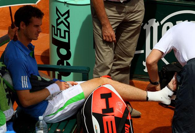 Andy Murray receives treatment during his victory at Roland Garros yesterday
