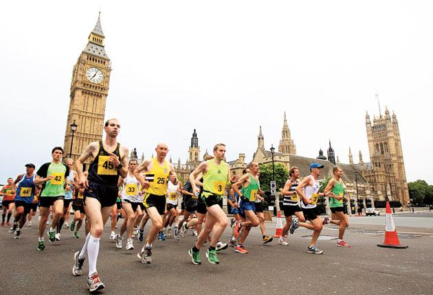 Club runners test out the Olympic marathon route in London yesterday