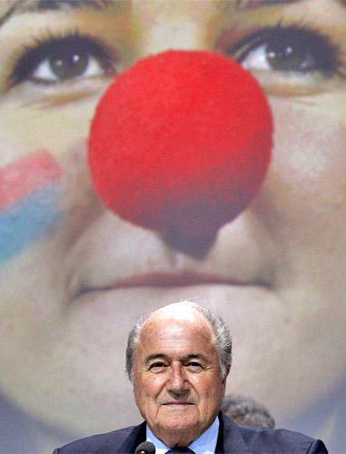 Sepp Blatter by an unfortunate backdrop