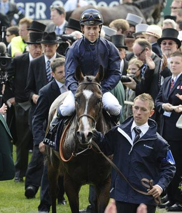 Pour Moi ridden by Mickael Barzalona celebrates winning The Investec Derby
