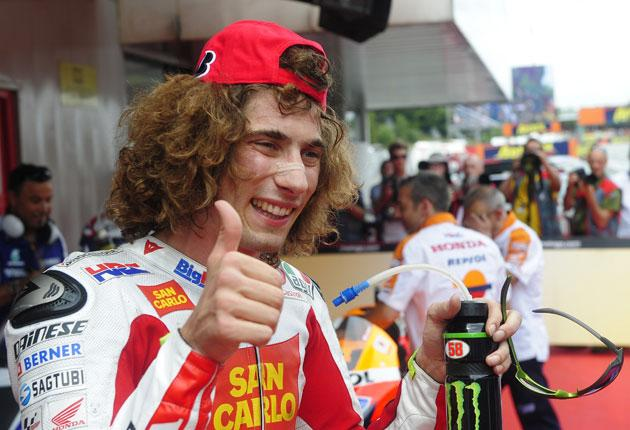 Simoncelli celebrates his first pole position