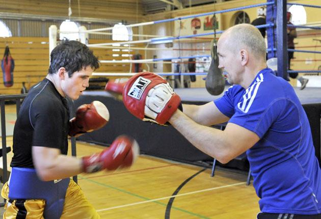Barry McGuigan sparring with his son Shane, an Ulster amateur champion