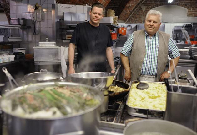 Joachim Berger (right) owns the Kartoffel-Keller in Lübeck; he says everything has been disinfected, and all staff tested for E.coli