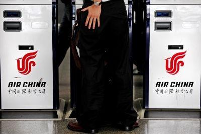 A passenger checks one of his pockets at the counters of Air China at the Hongqiao airport in Shanghai.